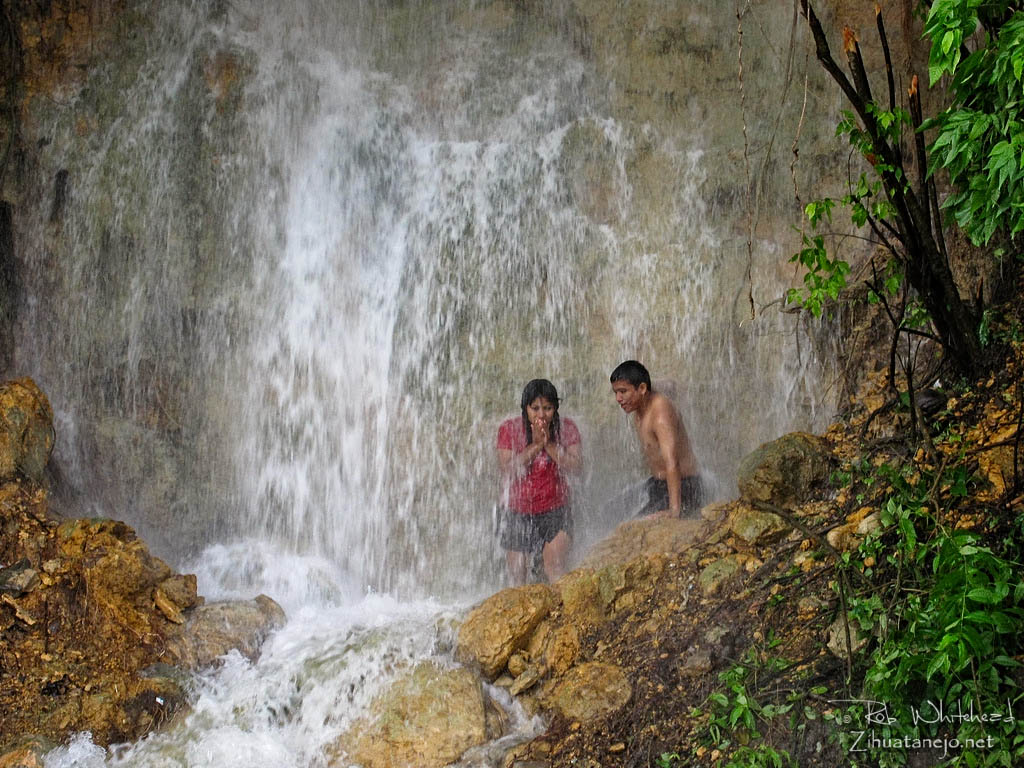 Young couple in waterfall, Ixtapa